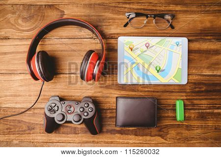 Map app against tablet music headphone wallet glasses and usb key