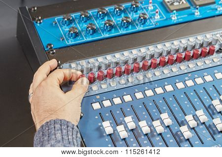 Finger Of A Man Turning The Knobs Of Audio Console
