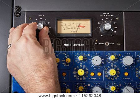 Turning Knob On Audio Equipment