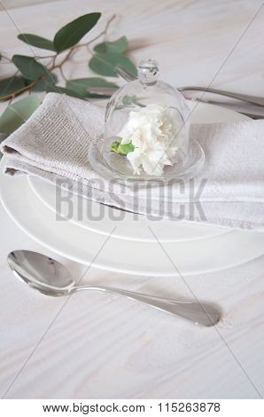 Decorated Table Setting With Linen Napkins, White Carnation Flowers And Silverware