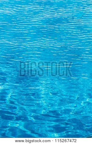 Ripples on the water in the swimming pool.