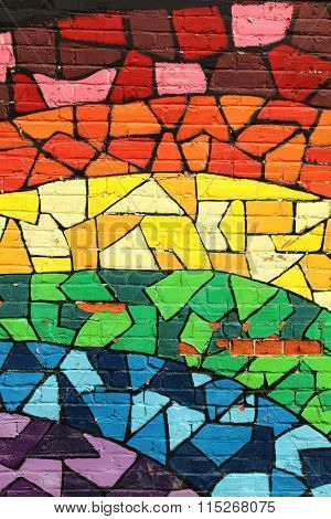 MONTREAL, CANADA-AUGUST 20th, 2014:  Rainbow stained glass pattern graffiti on a wall  in Montreal, Canada