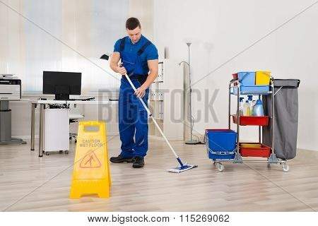 Janitor Mopping Floor In Office