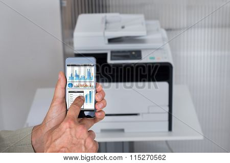 Businessman Giving Print Command On Smartphone