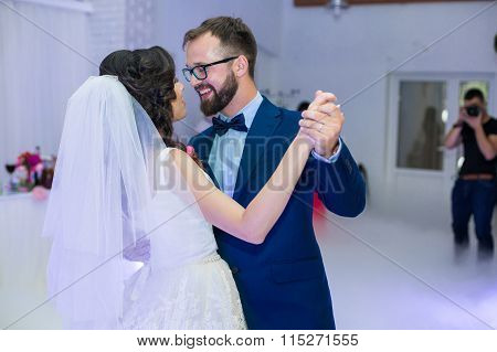 Happy Newlywed Couple Smiling During Their First Dance At Wedding Reception