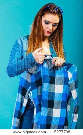 Fashionable Woman Trying Plaid Shirt