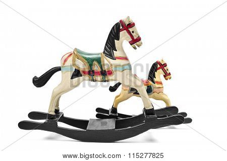 a pair of old wooden rocking horses on a white background