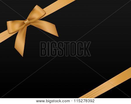 Gold Bow With Ribbons. Shiny Holiday Gold Satin Ribbon On Black Background. Gift Coupon, Voucher, Ca