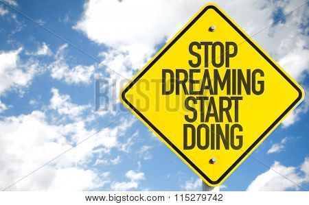 Stop Dreaming Start Doing sign with sky background