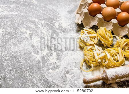 Pasta Background. Pasta With Eggs And Rolling Pin.