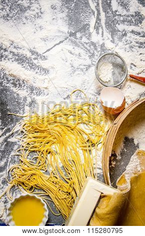 Cooking Noodles. The Pasta Maker With Strainer, Eggs And Flour.
