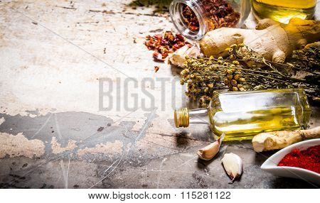 A Set Of Dried Spices And Herbs With Olive Oil.