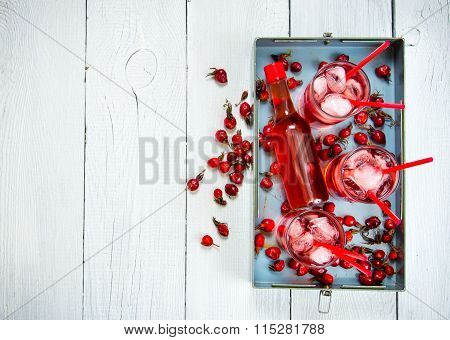 Three Berry Cocktail With Liquor And Ice On A Tray . Free Space For Text.