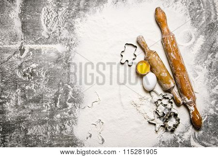 Preparation Of The Dough. Ingredients For The Dough - Eggs With Flour And Rolling Pins.