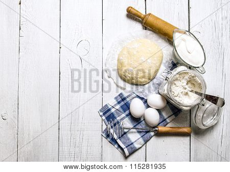 Preparation Of The Dough. Ingredients For The Dough - Flour, Eggs, Sour Cream With A Rolling Pin And
