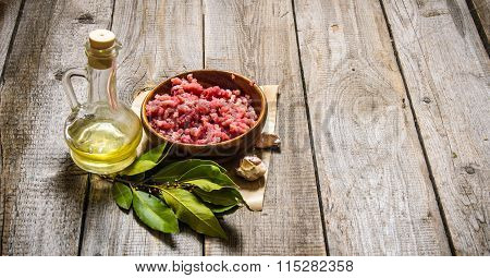 Fresh Minced In A Wooden Cup With Onion And Bay Leaf.