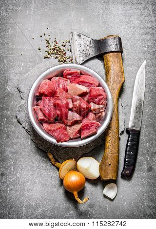 Chopped Raw Meat With An Axe, Cutting Knife And Spices.