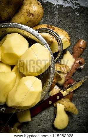 The Concept Of Wet Peeled Potatoes On The Stone Table .