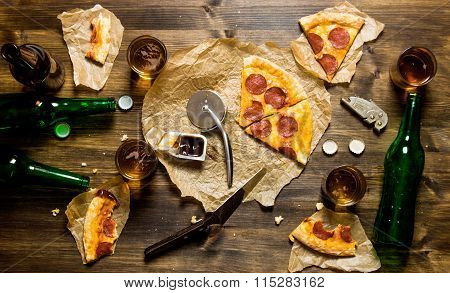 Pepperoni Pizza And Beer For Four People. On A Wooden Table.