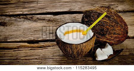 Fresh Cocktail In Coconut Cup On Wooden Background. Free Space For Text.