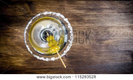 Martini With Olives On A Wooden Table. Free Space For Text.