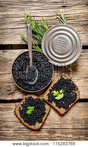 Sandwiches With Black Caviar, A Jar Of Caviar And Spoon.