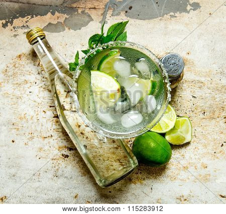 Ingredients Cocktail - Limes, Ice , Tequila, Salt And Liqueur On The Old Background .
