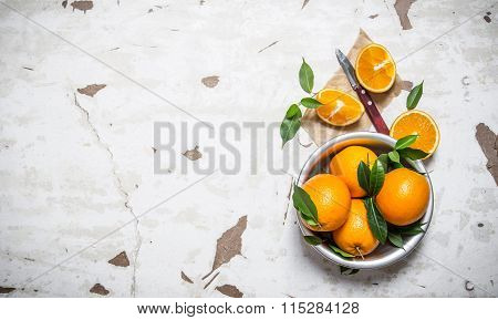 Orange Style. Fresh Oranges With Leaves In A Cup .