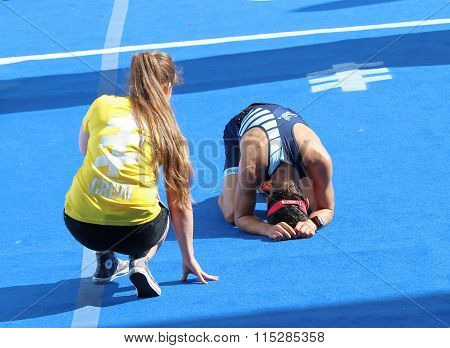 Exhausted Man Laying On The Ground After Running The Finnish In