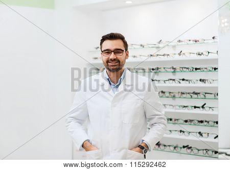 man optician in glasses and coat at optics store