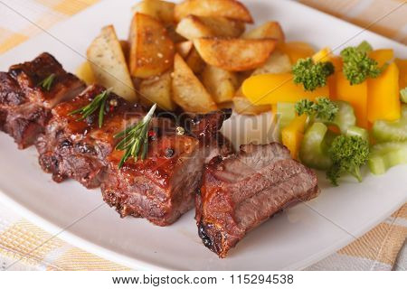 Delicious Bbq Pork Ribs With Salad And Potatoes Close-up. Horizontal