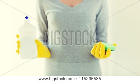 close up of woman with sponge and cleanser