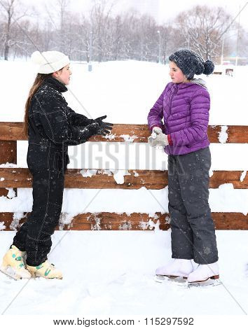 Two Teenager Girl On The Ice Rink