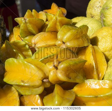 Delicious Star Fruit Lay In Cluster On Table