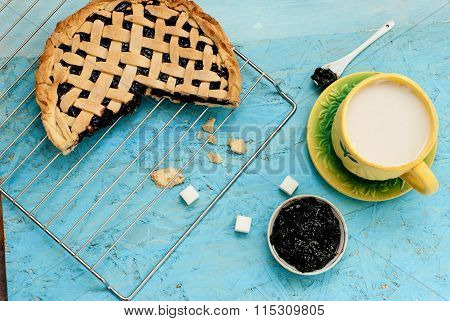Homemade Sand Cake With Cherry Jam On A Lattice And A Cup Of Tea