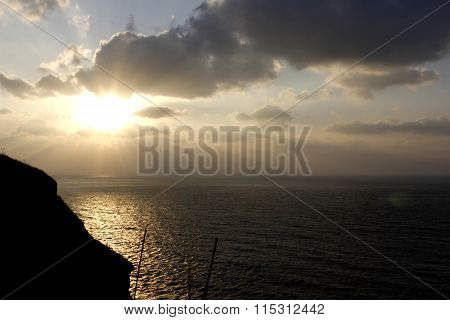 Sunset At Twilight Time On Seashore With Dark Grey Cloudy