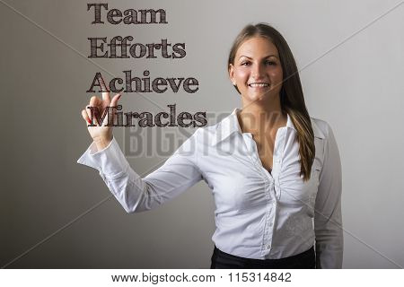 Team Efforts Achieve Miracles - Beautiful Girl Touching Text On Transparent Surface