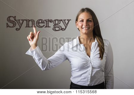 Synergy - Beautiful Girl Touching Text On Transparent Surface