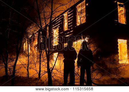 Firemans Trying to Safe House on Fire. Firefighter Emergency Ext