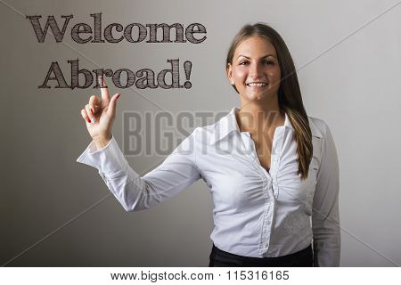 Welcome Abroad! - Beautiful Girl Touching Text On Transparent Surface