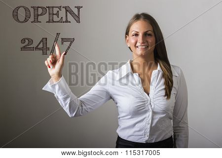Open 24/7 - Beautiful Girl Touching Text On Transparent Surface