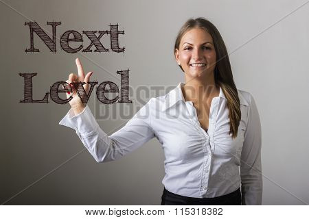 Next Level - Beautiful Girl Touching Text On Transparent Surface