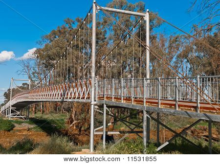 Suspension Footbridge Across An Australian Outback River
