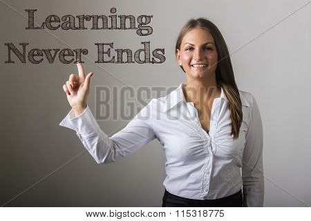 Learning Never Ends  - Beautiful Girl Touching Text On Transparent Surface