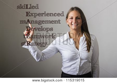 Skilled Experienced Management Develops Teamwork Strategy Leader - Beautiful Girl Touching Text On T
