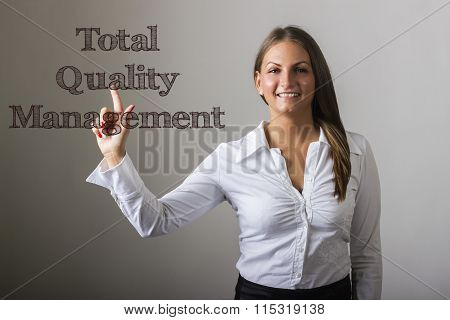 Total Quality Management - Beautiful Girl Touching Text On Transparent Surface