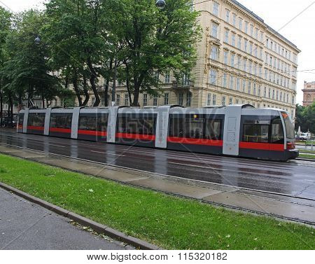 Red articulated tram