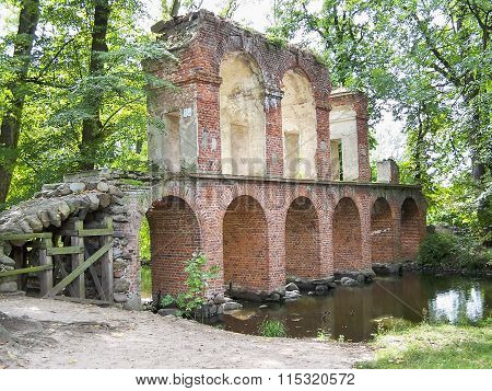 Ruins of aqueduct in a park in Arkadia, Poland