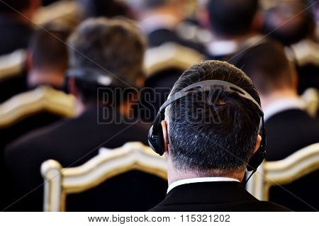 People Using Headphones During Conference
