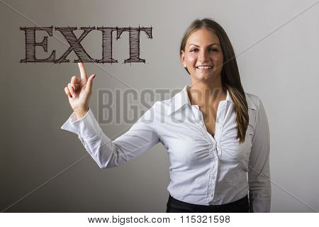 Exit - Beautiful Girl Touching Text On Transparent Surface